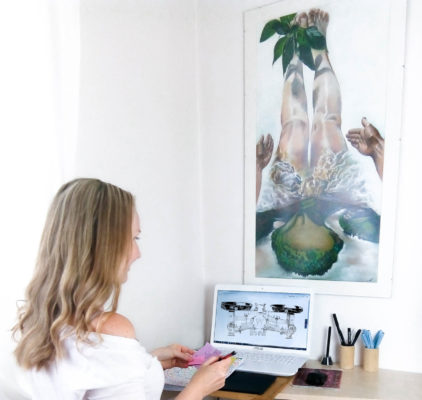 Artist with notes computer and wall art