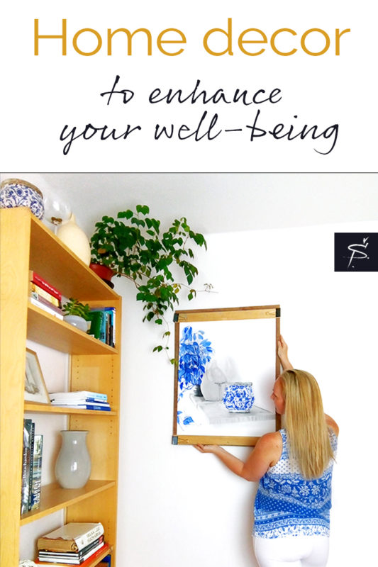Pinterest pin graphic artist hanging art in an interior