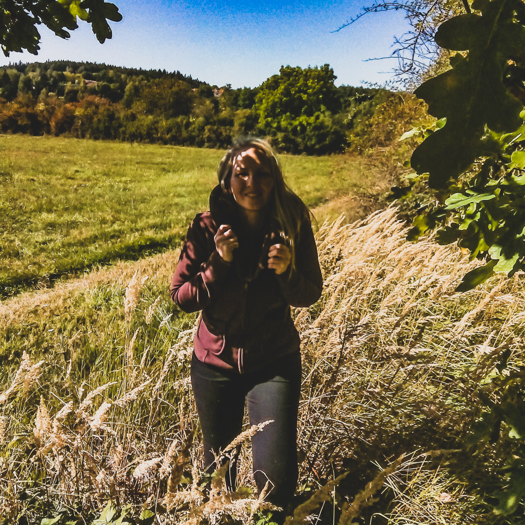 woman in fild of tall grass