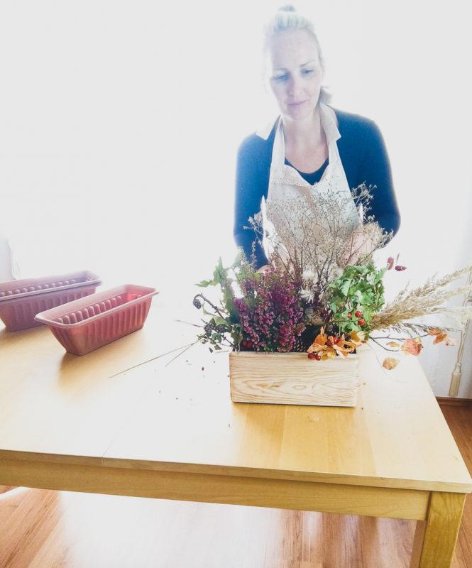 woman decorating flowers